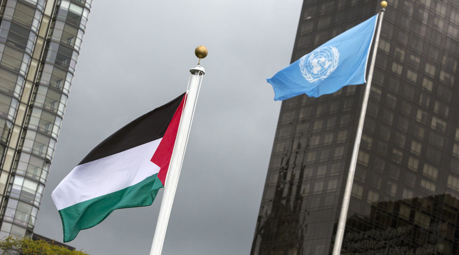 The Palestinian flag flies beside the flag of the United Nations after being raised by Palestinian President Mahmoud Abbas in a ceremony during the United Nations General Assembly at the United Nations in Manhattan, New York